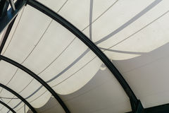 Fabric tensile roof structure with skylight. Translucent roof of light stretched over a steel frame fabric Stock Image