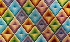 Fabric textile with bright patterns rhombus multi-colored background stock images