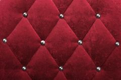 Fabric texture. Red stylish fabric with knobs Royalty Free Stock Photos