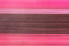 Fabric texture background in pink, purple, brown tones. Horizontal, striped fabric texture background in pink, magenta, purple, brown tones Stock Photos
