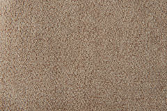 Fabric texture beige carpeting. For background Royalty Free Stock Images