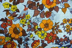 Fabric texture with bright flowers and brown bird royalty free stock images