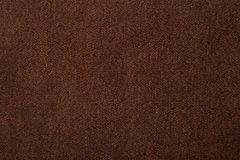 Fabric texture brown carpeting. For background Royalty Free Stock Image