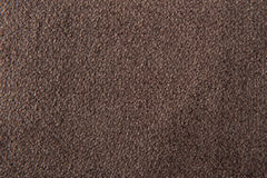 Fabric texture brown carpeting. For background Royalty Free Stock Images
