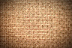 Fabric texture in brown, vignetted Royalty Free Stock Photography