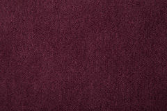 Fabric texture burgundy carpeting. For background Stock Photos