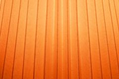 Close Up Background of Orange Pleated Textile Texture Stock Photo