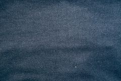 Fabric texture Dark blue color Pale.  Stock Images