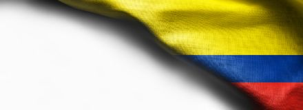 Fabric texture flag of Colombia on white background - right top corner royalty free stock photos