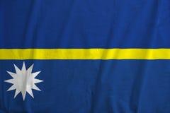 Flag of Nauru waving. Fabric texture of the flag of Nauru Royalty Free Stock Images