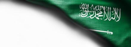 Fabric texture flag of Saudi Arabia on white background royalty free stock image