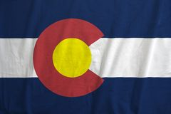 Flag of Colorado, USA waving. Fabric texture of the flag of the state of Colorado, USA waving stock image