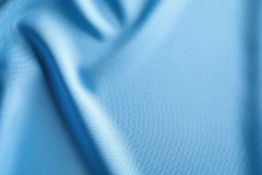 Fabric texture with folds. As background Royalty Free Stock Image