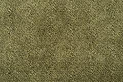 Fabric texture green carpeting royalty free stock images
