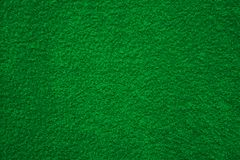 Fabric texture green carpeting. For background stock image