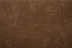 Fabric texture light brown carpeting. For background Royalty Free Stock Photo
