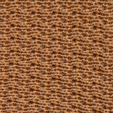 Fabric texture. Light brown wool large loop knitted fabric texture. Close up fragment of the top view Royalty Free Stock Image