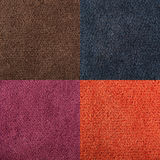 Fabric texture orange, brown, blue, magenta carpeting for backgr. Ound Royalty Free Stock Photo