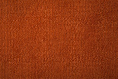 Fabric texture orange carpeting. For background Stock Image