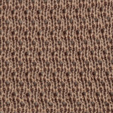 Fabric texture. Pastel brown wool knitted fabric texture. Close up fragment of the top view Royalty Free Stock Photos