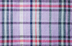Fabric texture and pattern. Fabric texture and cross pattern in purple, red and black color Stock Images