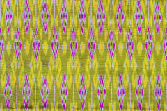 Fabric texture. Photograph of a pattern yellow and purple. Asian fabric texture stock photography
