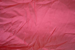 Fabric texture. A piece of silk fabric of bright pink Royalty Free Stock Photography