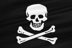 Fabric texture of the pirate flag waving in wind, calico jack pirate symbol, hacker and robber Royalty Free Stock Image