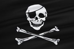 Fabric texture of the pirate flag waving in wind, calico jack pirate symbol, hacker and robber Royalty Free Stock Photos