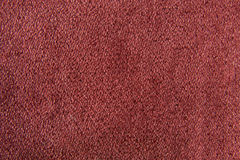 Fabric texture red carpeting. For background Royalty Free Stock Photography