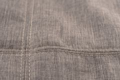 Fabric texture with seam stitch seam. Abstract background, empty template. Selective focus stock image