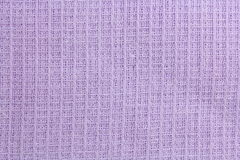 Fabric texture waffle towels in the cage, purple. Fabric texture waffle towels in the cage royalty free stock photography