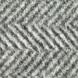 Fabric texture. Wool fleecy fabric with geometric black and white pattern texture.  Close up fragment of the top view Stock Images