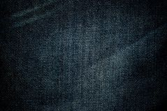 Worn jeans. Fabric texture worn jeans, background, fiber Stock Images