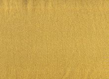 Fabric textures gold background stock photography