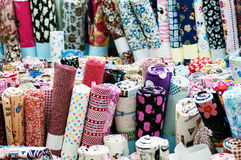 Fabric. Traditional fabric store with stacks of colorful textiles Stock Image
