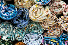 Fabric. Traditional fabric store with stacks of colorful textiles Royalty Free Stock Images
