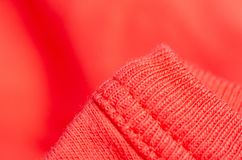 Fabric warm red orange sweater textile material texture stock photo
