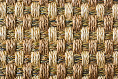 Fabric weaving texture. Brown fabric weaving texture on mat Royalty Free Stock Photo