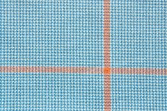 Fabric of white and blue color with orange cross. Abstract texture of textile checkered fabric of white and blue color with orange cross Royalty Free Stock Photos