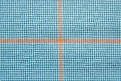 Fabric of white and blue color with orange cross. Abstract texture of textile checkered fabric of white and blue color with orange cross Royalty Free Stock Photography