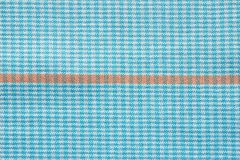 Fabric of white and blue color with orange strip Stock Photos