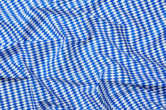 Fabric with a white blue diamond pattern Royalty Free Stock Images