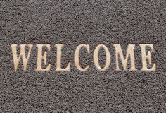 Fabric Wipe Foot and welcome text. Royalty Free Stock Photography