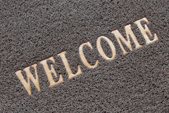 Fabric Wipe Foot and welcome text. Royalty Free Stock Photo