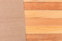 Fabric on wooden table. Soft brown woven linen fabric texture /. White wood texture background Royalty Free Stock Image