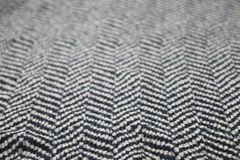 Fabric with zig- zag rows pattern on it. Illusion Stock Photography