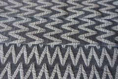 Fabric with zigzag pattern folded in three. Fabric with zig-zag pattern folded in three Stock Photography