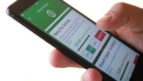 Fabricación de la donación de la caridad a la organización animal usando Smartphone App almacen de video