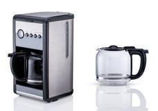 Fabricant de café sur le fond clair photo stock